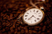 Old watch on the coffee — Stock Photo