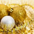 Tinsel and tree christmas balls — Stock Photo