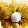 Stock Photo: Gold christmas balls and tinsel with reflection