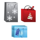 Set of 3 christmas present shopping bags — Stock Vector