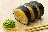Three sushi rolls with wasabi — Stock Photo