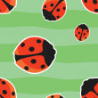 Seamless pattern with red ladybirds on green background — Imagens vectoriais em stock