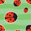 Seamless pattern with red ladybirds on green background — Stock Vector