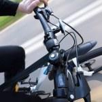 Man riding modern bicycle, handlebar top view — Stock Photo #45049617