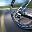 View of rear wheel with chain and cassette in motion — Stock Photo #45049631