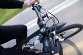 Man riding modern bicycle, handlebar top view — Stock Photo