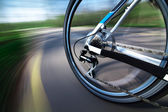 View of rear wheel with chain and cassette in motion — Stock Photo