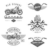 Set of retro motorcycle labels, badges and design elements — Stockvector