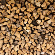 Background of chopped firewood logs in a pile — Stock Photo #47553145