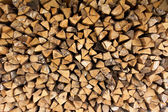 Background of chopped firewood logs in a pile — Stock Photo