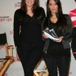 Постер, плакат: Khloe Kardashian and Kim Kardashian at a press conference to announce a Gl