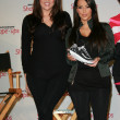 Stock Photo: Khloe Kardashiand Kim Kardashiat press conference to announce Gl