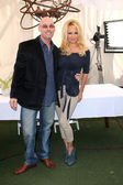 Julian Spitari, Pamela Anderson at a press conference for the New Online Social Platform FrogAds.com, Petit Ermitage, West Hollywood, CA 03-22-12 — Stock Photo