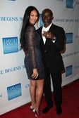 """Kimora Lee and Djimon Hounsou at the 3rd Annual """"Change Begins Within"""" Benefit Celebration, Los Angeles Times Central Court, Los Angeles, CA 12-03-11 — Stock Photo"""