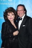 Joan Collins and Percy Gibson at the 2011 Unicef Ball, Beverly Wilshire Hotel, Beverly Hills, CA 12-08-11 — Zdjęcie stockowe