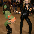 Alicia Arden as the Orion Slave Girl and Paula Labaredas as Catwoman  at Long Beach Comic-Con Day 2, Long Beach Convention Center, Long Beach, CA. 10-30-10 — Stock Photo