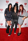 Janice Dickinson, Slash and wife Perla Ferrar — Zdjęcie stockowe