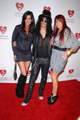 Janice Dickinson, Slash and wife Perla Ferrar — Стоковое фото