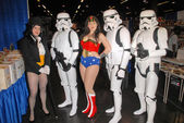 Jacquelyn D. Crinnion and costumed attendees — Stock Photo