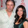 Постер, плакат: Kevin Nealon and wife at the Book Launch Party for Chelsea Chelsea Bang Bang by Chelsea Handler Bar 210 Beverly Hills CA 03 17 10