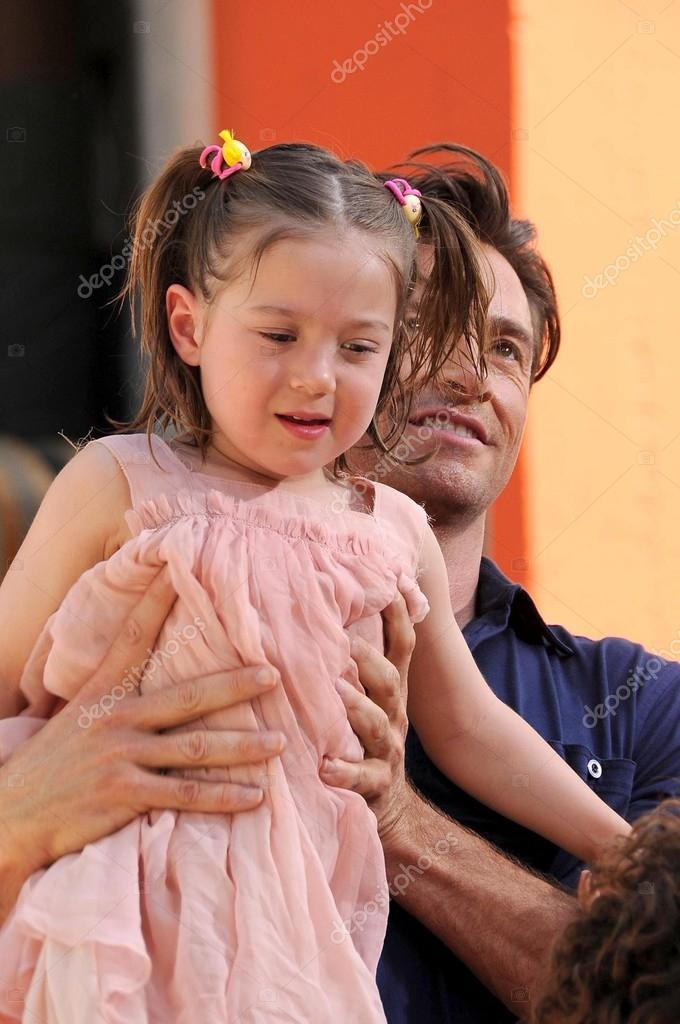 Hugh Jackman and his daughterat the ceremony honoring Hugh Jackman with Hand and Footprints in the courtyard of the Grauman's Chinese Theatre. Grauman's Chinese Theatre, Hollywood, CA. 04-21-09 — Stock Photo #15137061