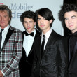 Постер, плакат: Rod Stewart and Nick Jonas with Joe Jonas and Kevin Jonas