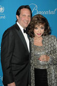 Joan Collins and husband Percy Gibson at the 2009 UNICEF Ball Honoring Jerry Weintraub, Beverly Wilshire Hotel, Beverly Hills, CA. 12-10-09 — Zdjęcie stockowe