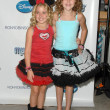 Постер, плакат: Emily Grace Reaves and Noah Cyrus at the Myzos Launch Party Fred Segal Santa Monica CA 08 22 09