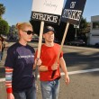 Постер, плакат: Katherine Heigl and T R Knight at the Writers Guild of America Picket Line in front of Paramount Studios Hollywood CA 12 12 07