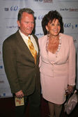 John Savage and Sandi Schultz — Stock Photo
