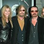 Постер, плакат: Tom Petty and wife Dana with David A Stewart and wife Anoushka