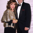 Joan Collins and Percy Gibson at the 2007 World Magic Awards to benefit Feed The Children. Barker Hangar, Santa Monica, CA. 10-13-07 - Stock Photo