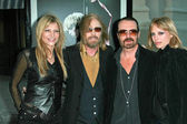 Tom Petty and wife Dana with David A. Stewart and wife Anoushka — Stock Photo