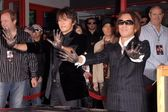 Koshi Inaba and Tak Matsumoto at the induction ceremony for the group B'z into the Hollywood Rockwalk. Guitar Center, Hollywood, CA. 11-19-07 — Stock Photo