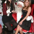 Stock Photo: Khloe Kardashiand Adrienne Bailon at Ed Hardy Holiday Party. Ed Hardy Store, Hollywood, CA. 12-14-07
