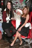Khloe Kardashian and Adrienne Bailon at the Ed Hardy Holiday Party. Ed Hardy Store, Hollywood, CA. 12-14-07 — Stock Photo