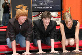 Rupert Grint with Daniel Radcliffe and Emma Watson — Stock Photo