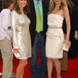 Постер, плакат: Kelly Preston with John Travolta and Michelle Pfeiffer at the Los Angeles premiere of Hairspray The Mann Village Theatre Westwood CA 07 10 07