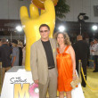 Постер, плакат: Albert Brooks and wife Kimberly at the World Premiere of The Simpsons Movie Mann Village Theatre Westwood CA 07 24 07