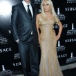 Постер, плакат: Rupert Everett and Donatella Versace
