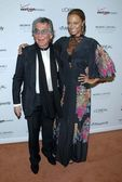 Roberto Cavalli and Tyra Banks — Stock Photo