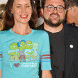 Постер, плакат: Kevin Smith and Jennifer Schwalbach Smith at the World Premiere of The Simpsons Movie Mann Village Theatre Westwood CA 07 24 07