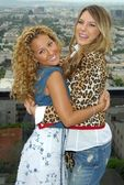Adrienne Bailon and Belinda Peregrin at The Cheetah Girls 2 interview session. The Mondrian Hotel, West Hollywood, CA. 08-01-06 — Stock Photo
