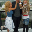 Постер, плакат: Adrienne Bailon with Golan Yosef and Belinda Peregrin at The Cheetah Girls 2 interview session The Mondrian Hotel West Hollywood CA 08 01 06