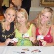 Stock Photo: Katie Lohmann with AlanCurry and MelissMoJo Hunter at Bench Warmer World Cup 2006 Trading Cards Autograph Session. Bel Age Hotel, Los Angeles, CA. 06-22-06