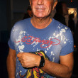 Stock Photo: Robert Shapiro wearing T-Shirt by Ed Hardy and watch by Croton