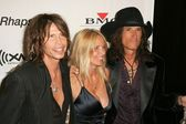 Steven Tyler with Joe Perry and his wife — Fotografia Stock