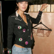 Adrianne Curry trying on clothing at Antik Denim. West Hollywood, CA. 12-08-05 - Stock Photo