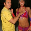Stock Photo: Adrianne Curry is oiled up by Christopher Knight at Lingerie Bowl III Celebrity Quarterback Photo Shoot, Private Location, Long Beach, C05-27-05