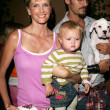 Kylie Bax with Spiros Poros and daughter — Stockfoto #16649977